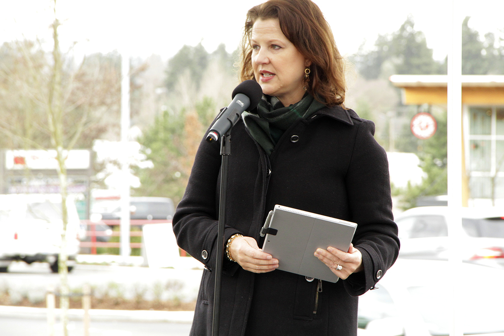 Mayor Amy Walen addressed the 30-plus member crowd Wednesday in Honda of Kirkland's auxiliary car lot.