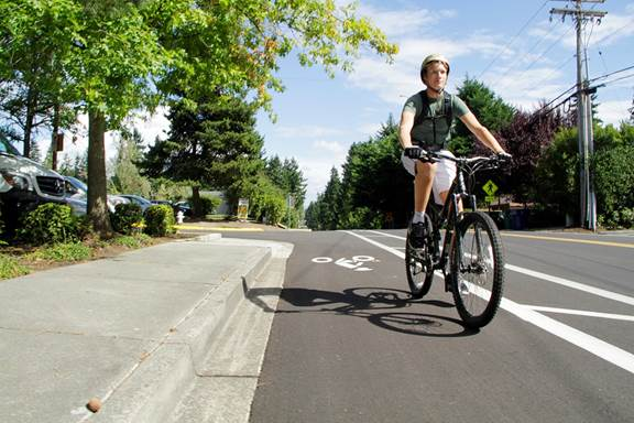 A bike rider uses the bike lanes along Northeast 141st Street shortly after the City of Kirkland created the bike lanes during the 2015 paving process. The City Council is will consider an ordinance on July 19 that will improve safety for bicycle riding by ensuring bike lanes are clear from parked vehicles.