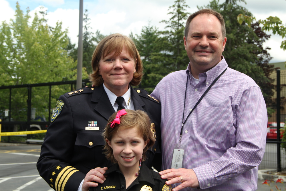 Chief Cherie Harris, Tiffany Larson and City Manager Kurt Triplett