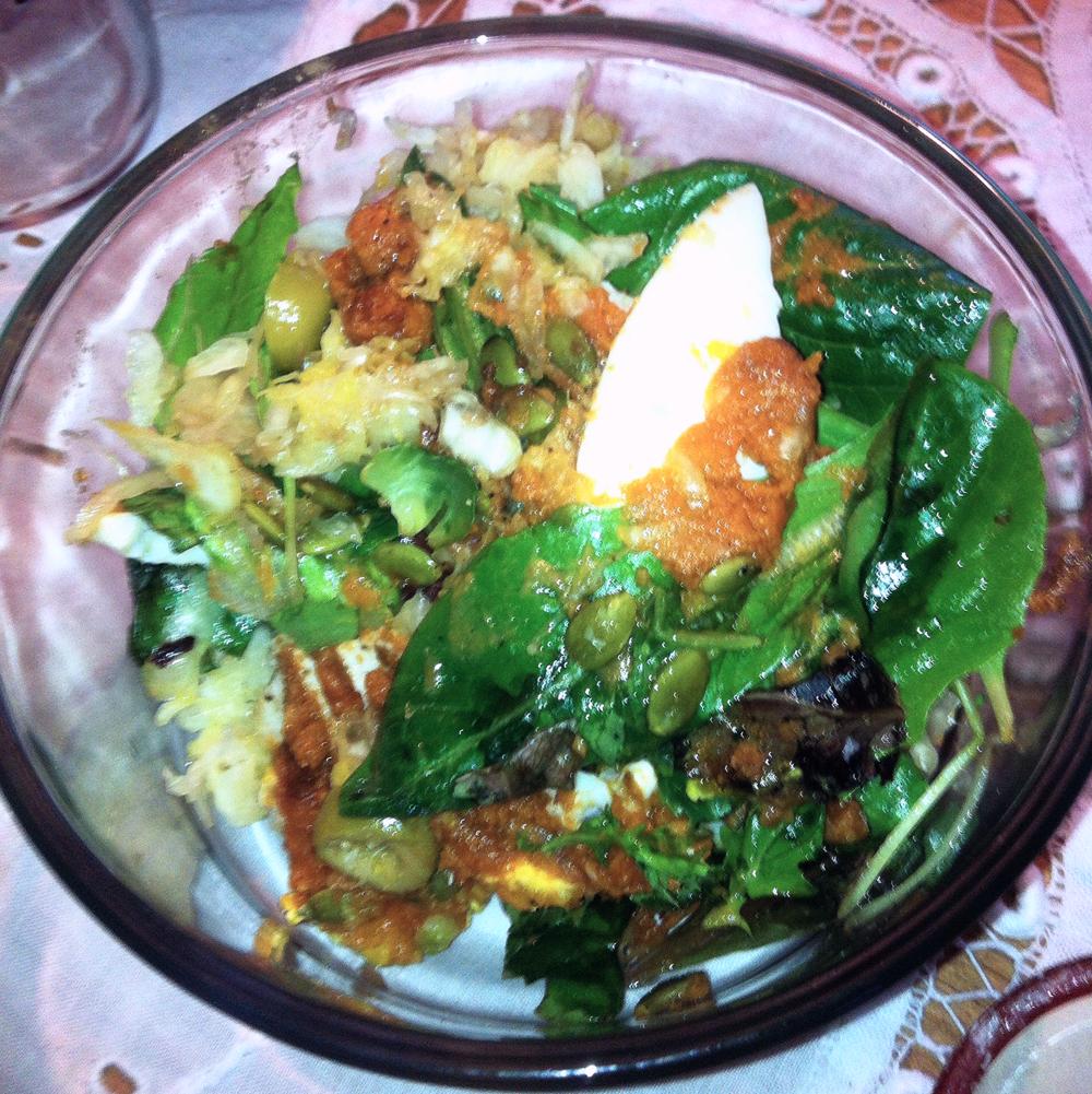Warm pumpkin and egg salad with pumpkin seeds and balsamic vinegar