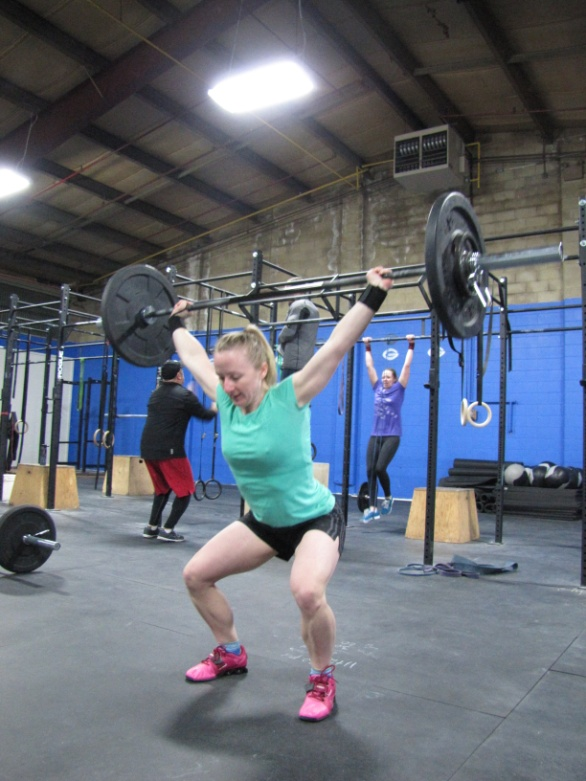 Bailey power snatching at least 65 lbs! Oh how I covet those pink lifting shoes!