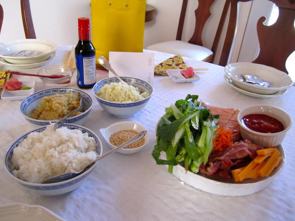 Sushi party table setup: cauli-rice, quinoa, and sushi rice plus sushi fixings.