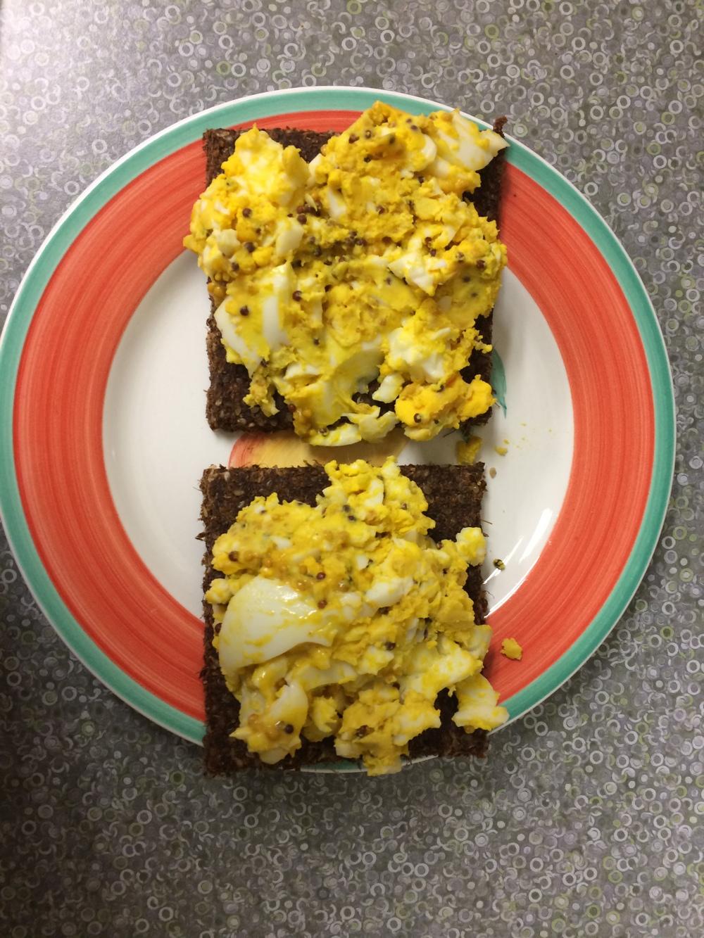 "Dijon egg salad pumpernickel open-face sandwich on live organic raw foods' kale caraway ""bread"""