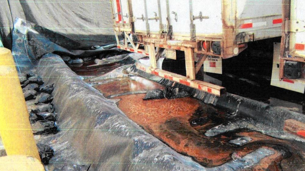 "After an October 2013 inspection by the California Department of Toxic Substances Control, regulators wrote that ""Water which leaked from the 40-foot trailers appeared to puddle over a period of time."" (California Department of Toxic Substances Control)"