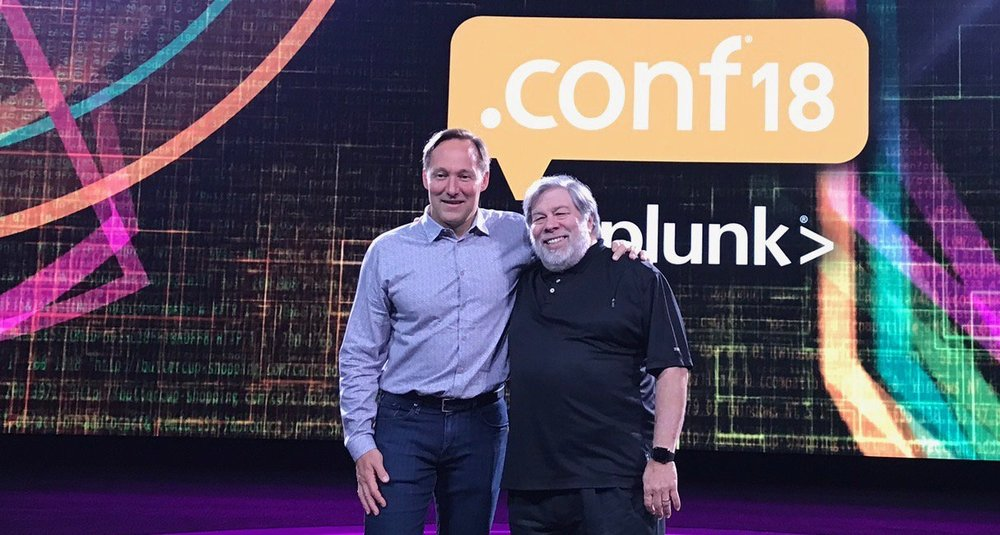 Splunk CEO  Doug Merritt  and  Steve Wozniak  pose in front of  CODesign's  .conf18 Conference Video Graphics.