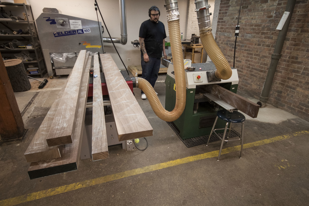 Planing, jointing, and ripping to size. Squaring up raw material is a large part of woodworking, and it's hard work. This is at the Chicago School of Woodworking in Lincoln Square.