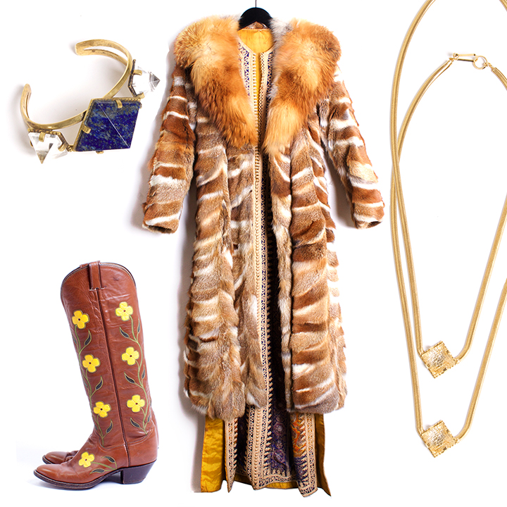 "THE BOHO GIRL    UNEARTHEN  ""Pyxis"" Cuff in Ox Lapis and Quartz - $550,  VINTAGE  70s Fox Fur Coat - $895 size S/M,  VINTAG E 70s Moroccan Robe - $525 size O/S,  LARRY MAHAN  70s Western Floral Boots - $295 size 9,  UNEARTHEN  ""Pyxis"" Quartz Necklace - $310 each."
