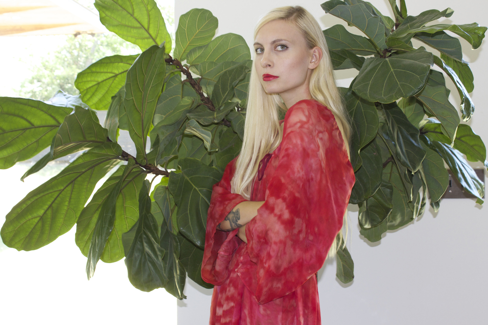 We are so in love with this 1970s hand-dyed red silk dress! To shop it,  click  here .  Model Rachel Baker. Photography  Katy Shayne . Styling Masha Poloskova.