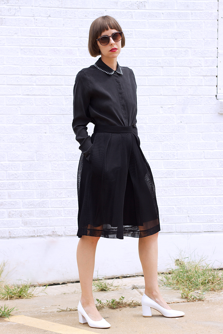 7115 by SZEKI Stitched Collar Blouse $185 (sizes XS,S,M available), 7115 by SZEKI Fishnet Skirt in Black $190 (sizes XS,S,M,L available).