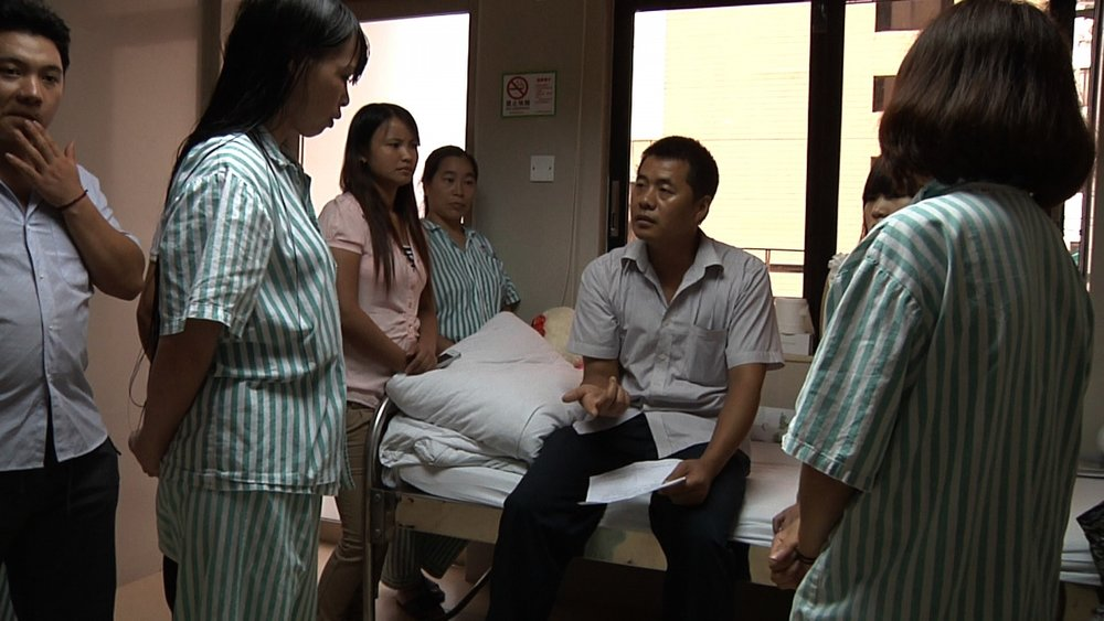 Yi has been helping workers fight for compensation after being poisoned at work-b.jpg