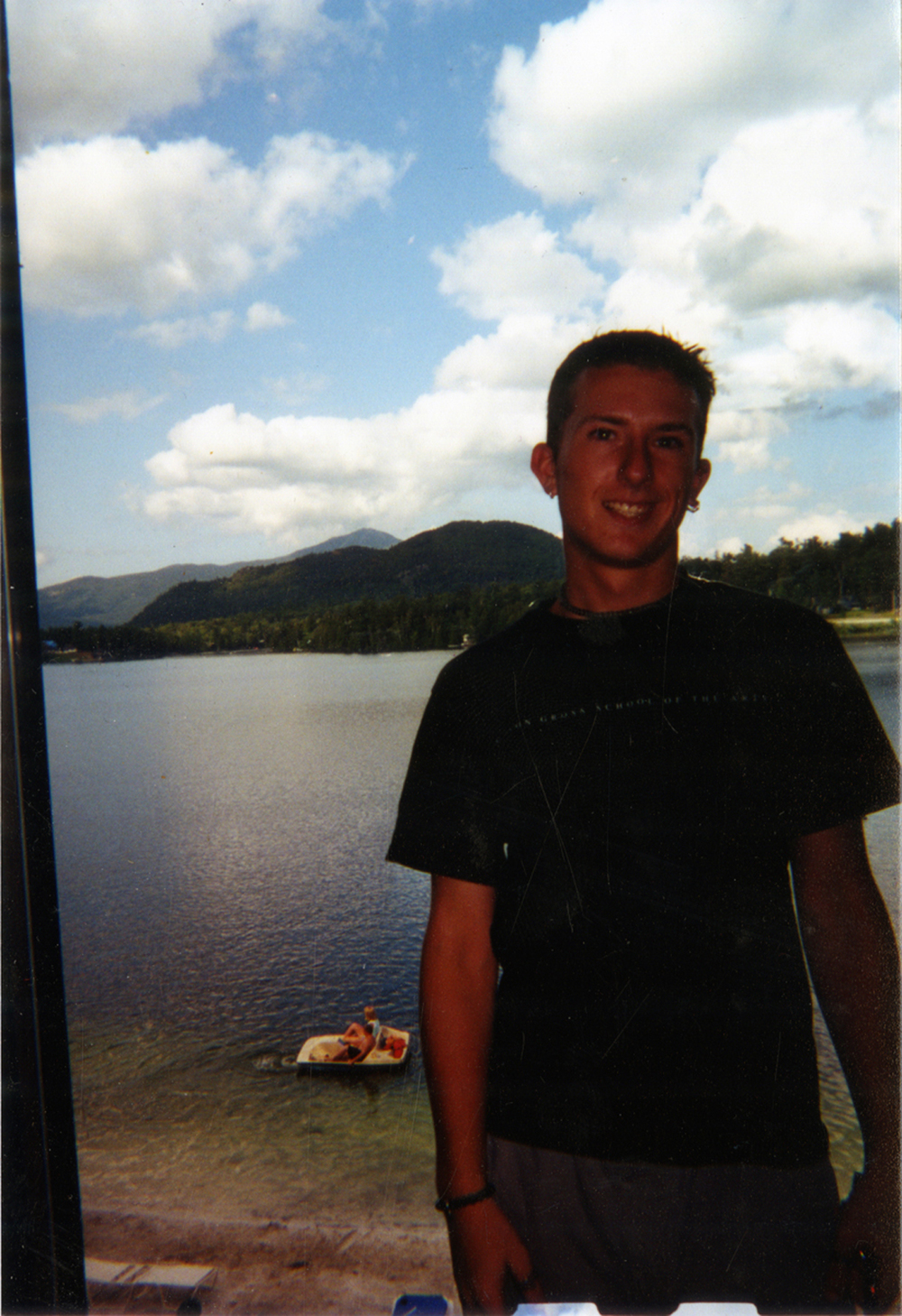 "Artifact #1 - Portrait of the artist on family vacation in 2000, wearing ""Mason Gross School of the Arts"" t-shirt; 3"" x 5"" color snapshot."