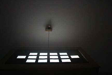 'Home' documentation photos, printed on transparencies, shown on a light table.