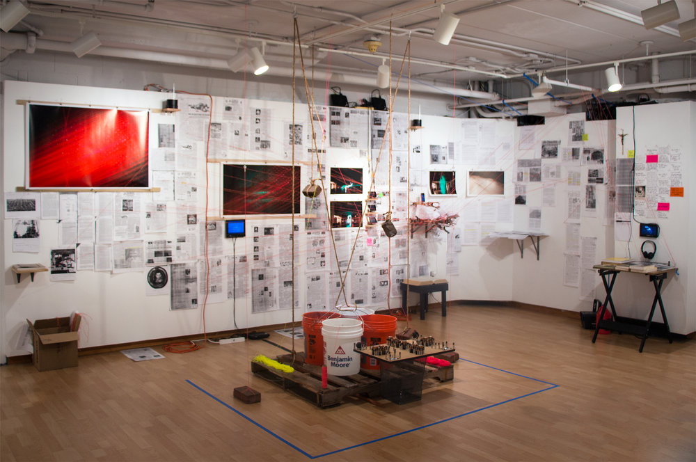 Untitled (The InBetween & Intersection of Torpedo Timelines)  Installation: research, photographs, video, water from the Potomac River, buckets, bricks from the site, construction line, rope, batteries, other found objects, ghost hunting equipment, small library of books, small metal trash can, wood pallet. 2015