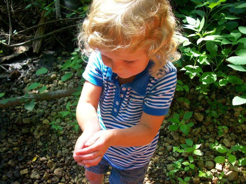 girl holding frog.jpg