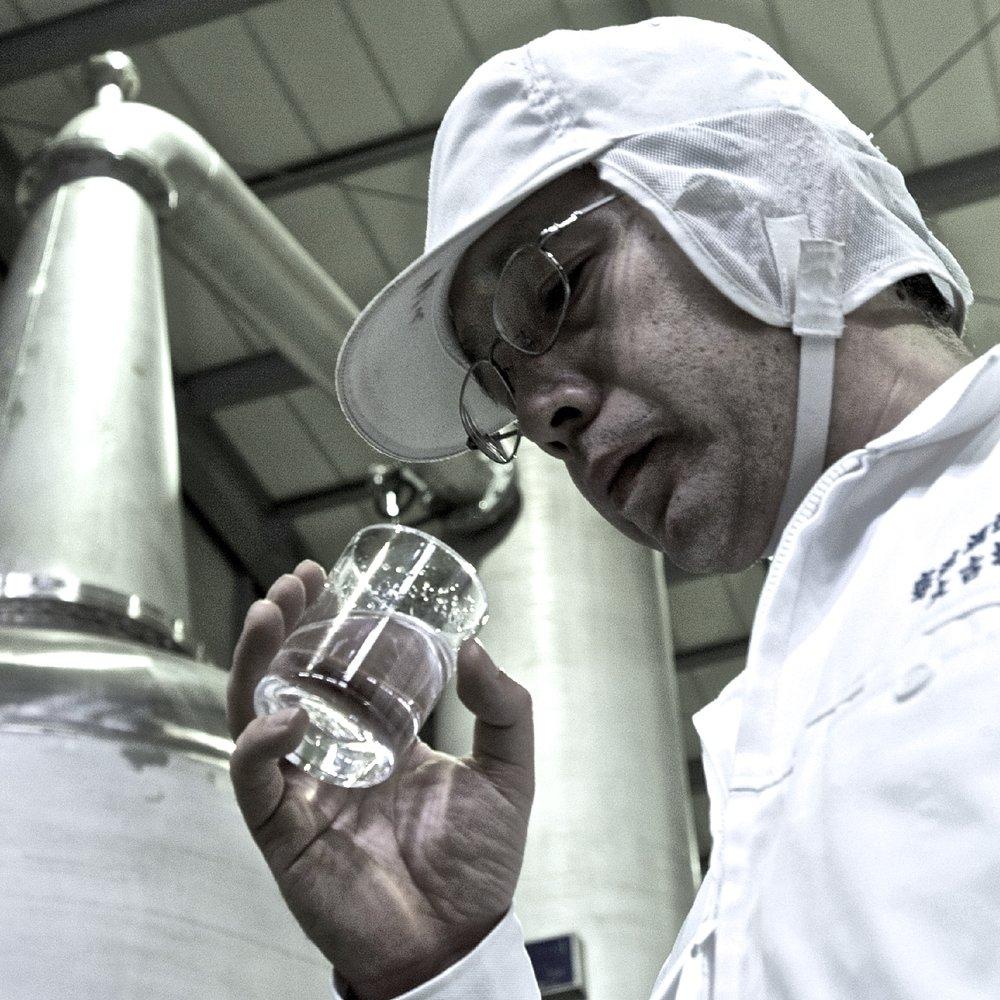 Toji (Master Distiller) Hirofumi Okoba samples fresh genshu.