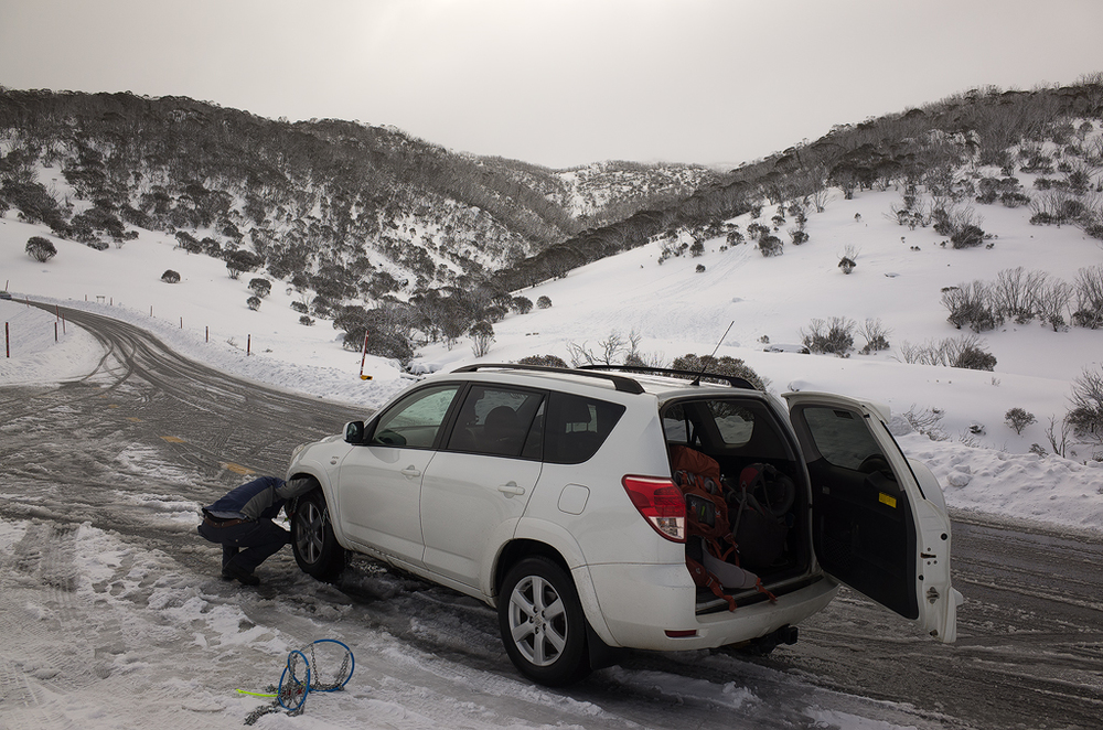 Gav putting snow chains on the Rav