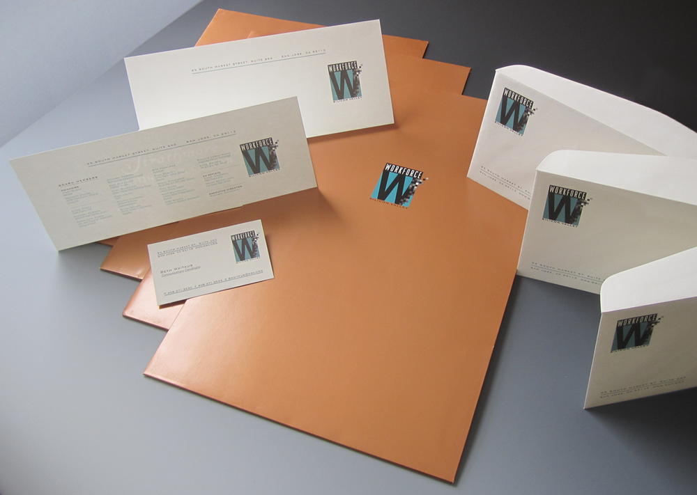 This package includes logo design with multiple applications, including a folder, two letterhead configurations, business cards, envelopes, labels, mugs, t-shirts, hats. The letterhead features metallic ink on an uncoated stock; the coated folder, metallic inks with a matte varnish overall.