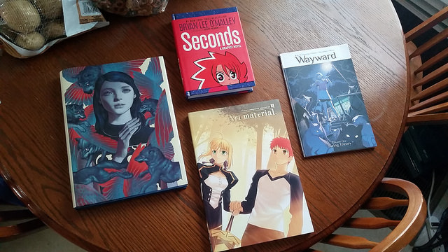 From left to right: The Fable Covers by James Jean, Seconds by Bryan Lee O'Malley, the Fate/Complete Art Material Book, and Volume 1 of Wayward