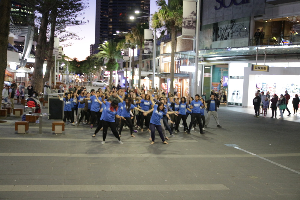 Clap along if you know that happiness is the truth! Henry Cavill Mall had no idea what was in store when a group of blue shirted uni students started dancing like maniacs!