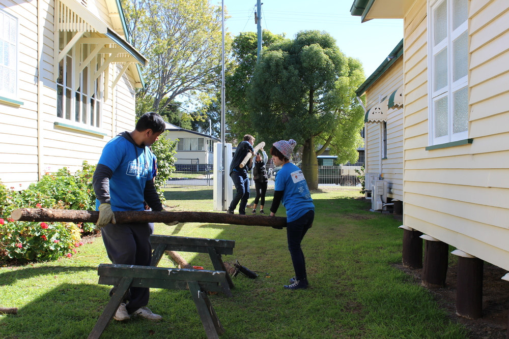 (Photo Credit: Evelyn Tran) David, Sam, Binh & Sarah (otherwise known as Rapunzel for her super long hair) hard at work building wooden fences for the flowerbeds