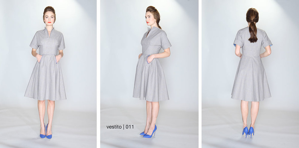 vestito | 011 the darted bodice dress 100% cotton grey plaid canvas. Kimono sleeve dress with flared skirt. Cap sleeve with cuff. Front pockets with royal blue silk/wool contrast trim. Fully lined. Dry clean only.