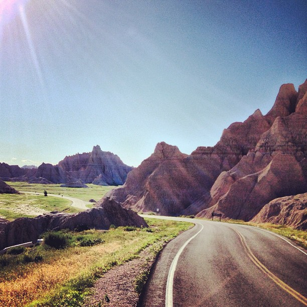 Flashback to the Badlands One of our favorite roads so far, back from Stage 11. A twisty switchback that climbs out of the Badlands and through these rock formations. Insanely awesome. (at Badlands National Park)