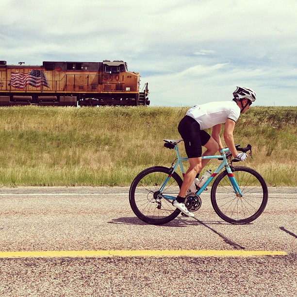 Sure, lets do train sprints.   Stage 10 is done and we are in South Dakota. 148 miles at 95+ degrees with a headwind in every direction. Plus the landscape was a little monotonous, so we added train sprints to our normal county line sprints. It made the day a little more interesting. (at Everything looks the same)