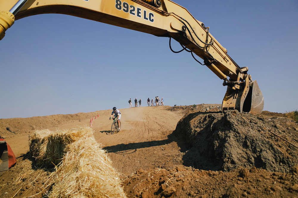 What other race has you riding under the construction equipment that built the course?