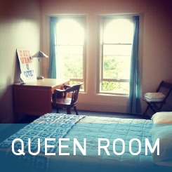Queen bed, lamp, desk, a/c, ceiling fan, night light, single shared bath across the hall.  Rooms 30 & 31.