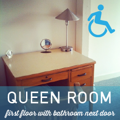 Accessible room, queen bed, lamp, desk, a/c, ceiling fan, night light, private accessible bathroom right next door.  Room 10.