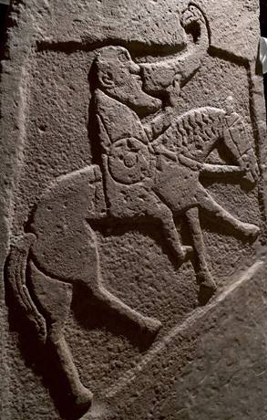 A Pictish equestrian drinking while riding.