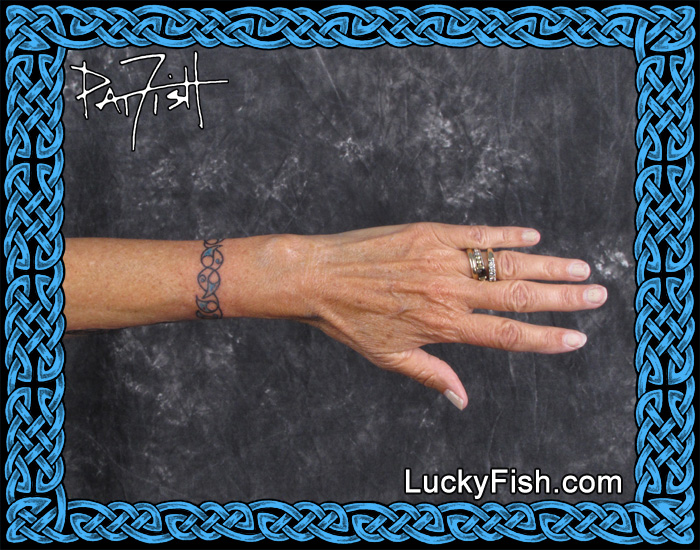 Delicate Celtic Bracelet Tattoo by Pat Fish