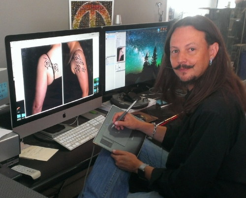 Here he was using computer skills mocking up a client's tattoo - which still MIGHT happen if you  make an appointment !