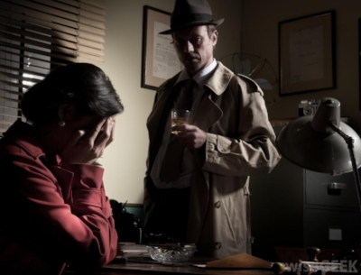 woman-with-hands-covering-face-near-detective-in-office.jpg