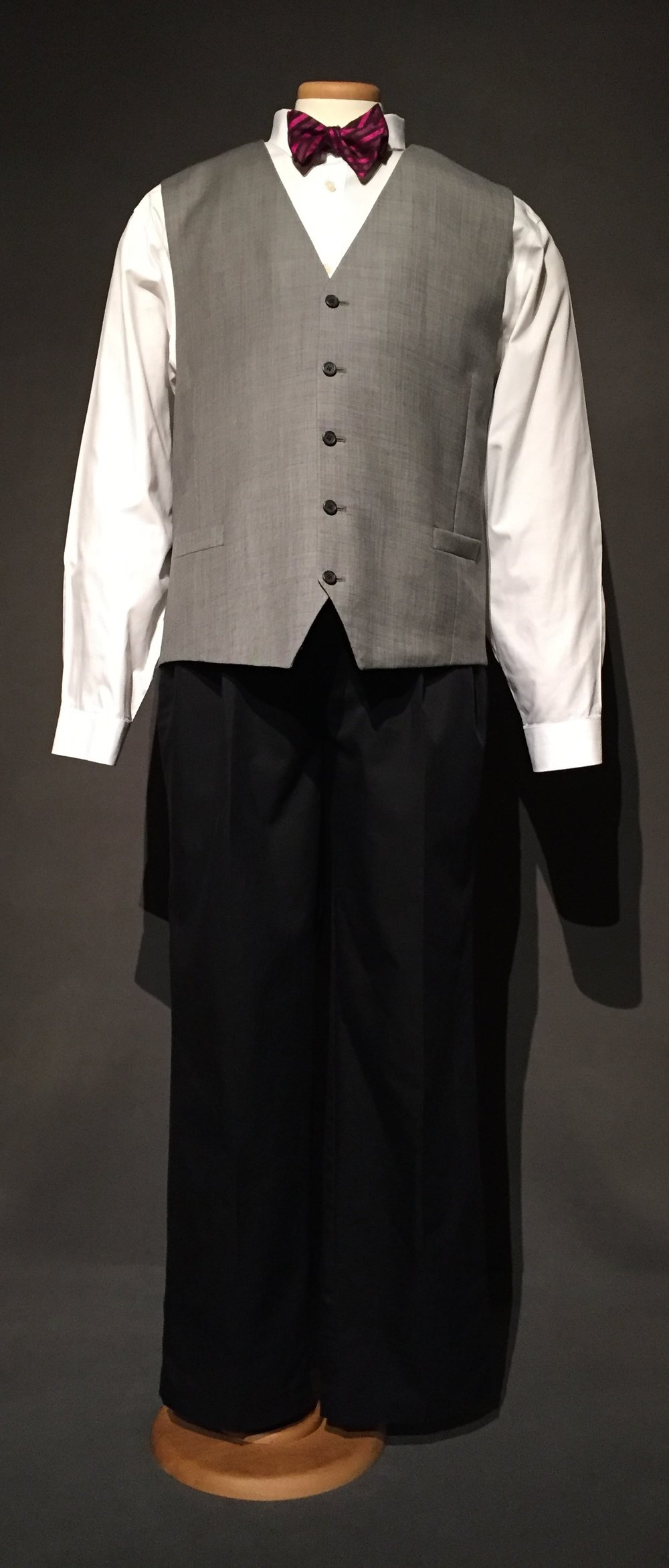 """- White button down, pink tie, grey vest, (Jennifer loan) blue pleated front pant (anonymous loan)Owner – Jennifer, lesbian, genderqueer, 50, lives in Iowac. 2010s""""I dress like a man. I mean I present like a man, I think everything that I have on except underwear is on the man side."""" -personal interview with Jennifer, October 28, 2017"""