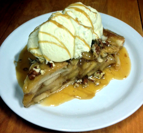 Barista's Signature Caramel Apple Pecan Pie Heated with Vanilla Ice Cream and Caramel Drizzle.