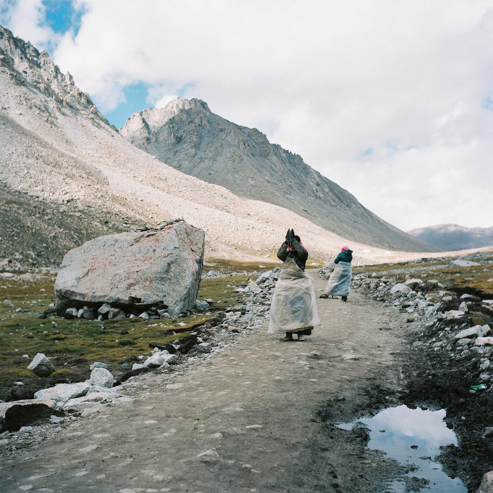 Buddhist pilgrims prostrating around Mt. Kailash.jpg