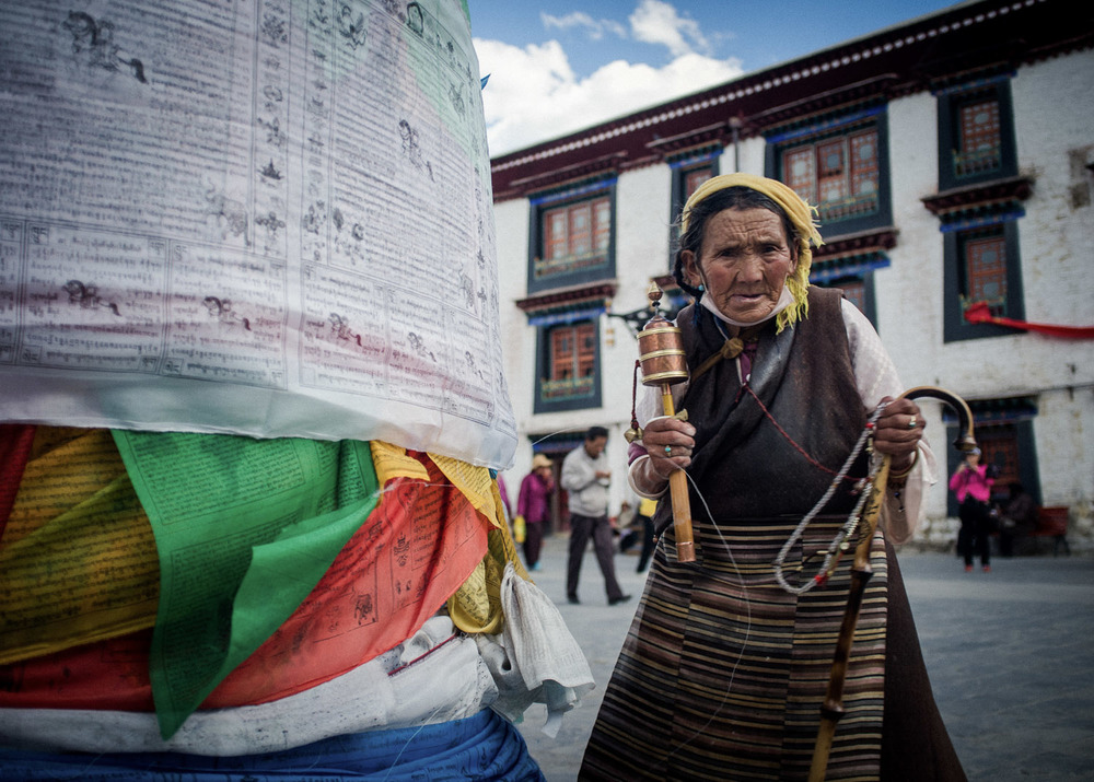 Woman with prayer wheel, Lhasa, Tibet.jpg