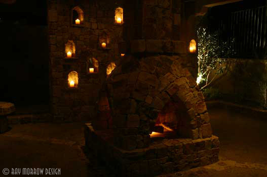 lit-stone-fireplace-and-candle-wall-jones-newport-ridge-north.jpg