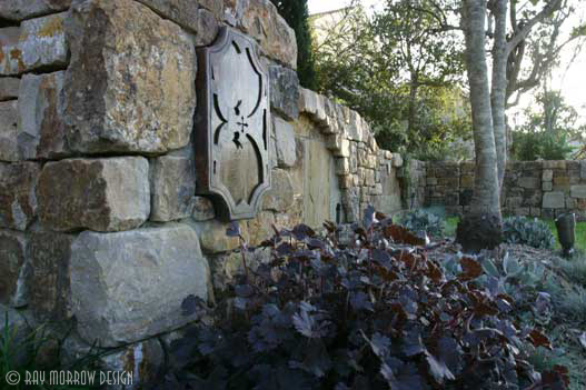 stone-entry-wall-with-custom-light-jones-newport-ridge-north.jpg