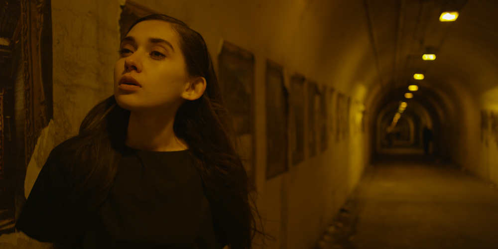 One of our models, Alexandra Chelaru. (still from the film)
