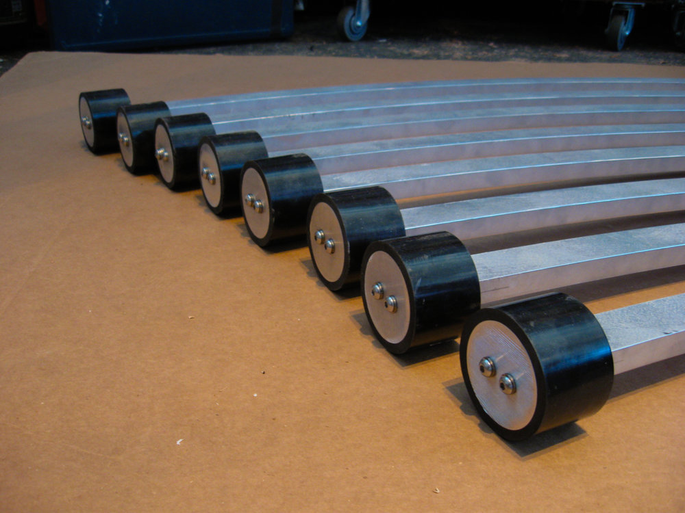 Mallets, machined out of 2 inch diameter aluminum rod for weight, and covered with PVC tubing to achieve a soft strike as well as for weather and UV resistance
