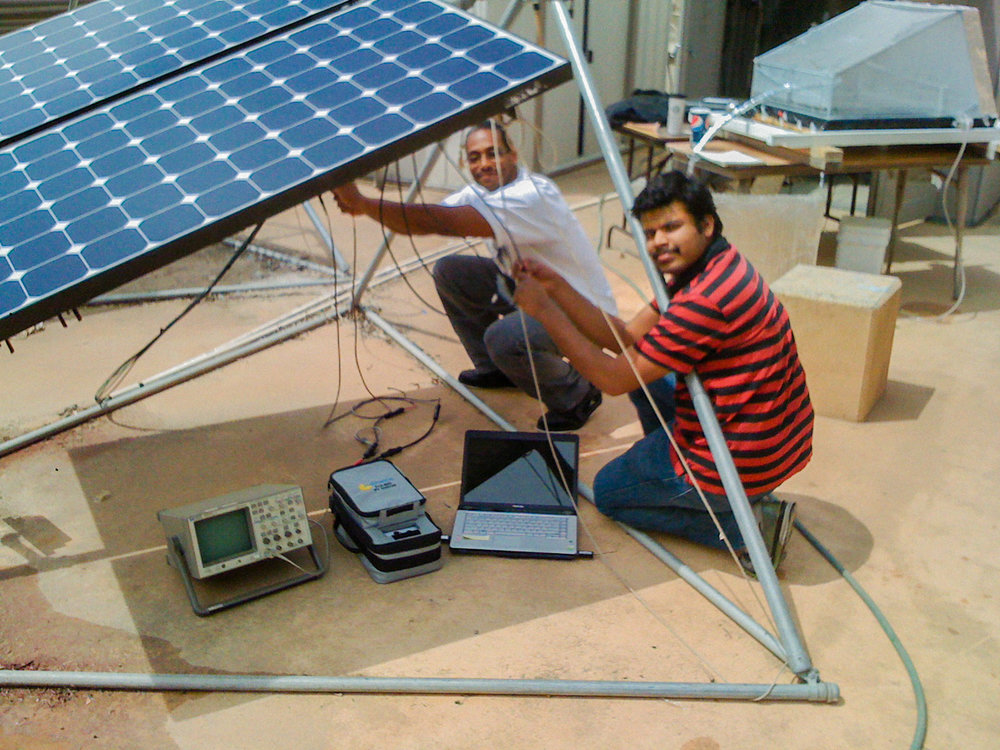 Nate and Aravind setting up the I-V Curve Tracer for assessing photovoltaic panel performance
