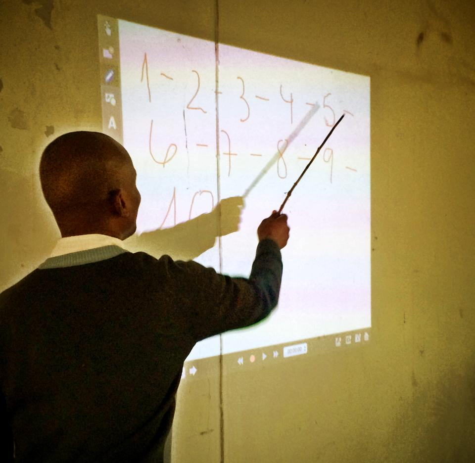 teacher using siab - mozambique, africa