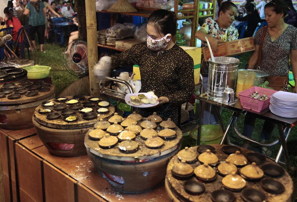 Gourmandise sur le marché de nuit de Ben Thanh
