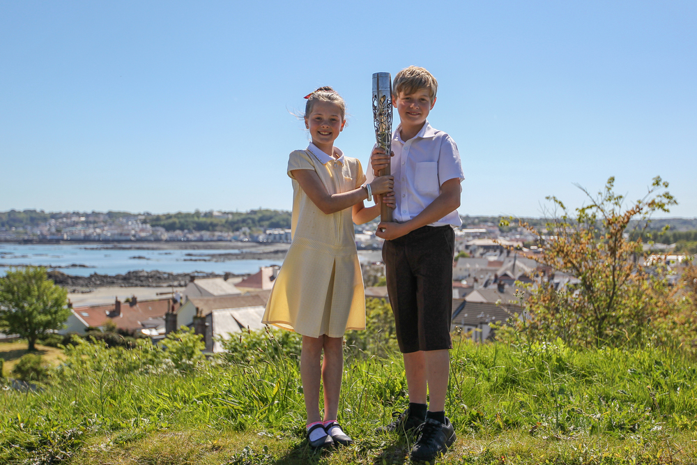 Some scenic shots of the Queen's Batons visit to Guernsey….Seanna Hainsworth and Leighton Woodhead overlooking Belgrave Bay…. Click on the photo to see where the Queen's Baton visited during it's stay...
