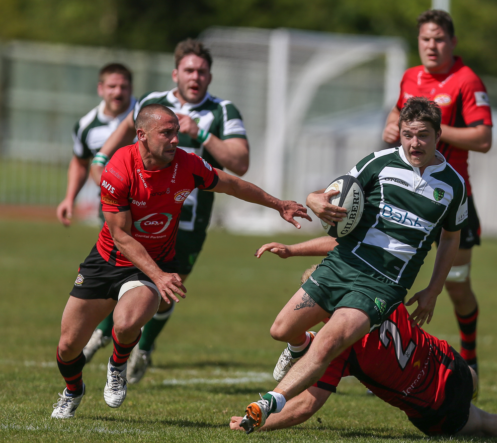 Guernsey RFC's Dale Rutledge shows his pace against Jersey in the Siam Cup 2014