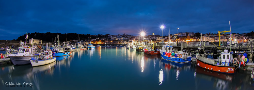 'Waiting for the Tide'... The Fisherman's Quay in St Peter Port Harbour....