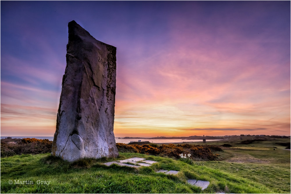 'Waiting for the Sun'... The Millennium Stone at Lancresse Common....