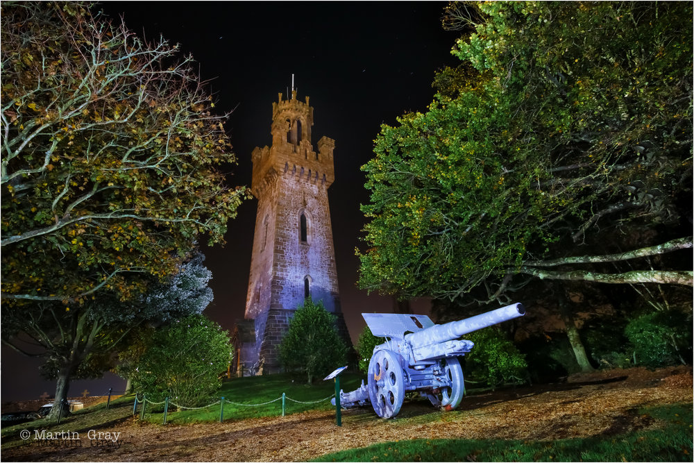 'Victoria's Secret'... A night shot of Guernsey's Victoria Tower built in 1848... the foreground gun is one of two German 13.5cm field howitzers in the garden...